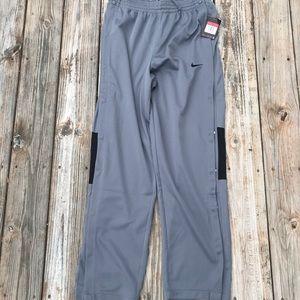 Nike basketball pants, button down sides. Sz L.